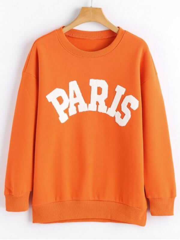 Moletom laranja escrito Paris